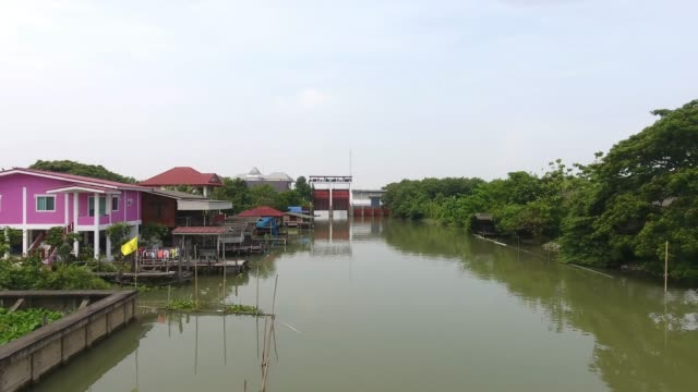 village, aerial view of thai house style along canal. - canal stock videos & royalty-free footage