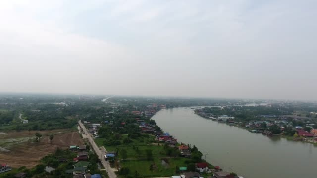 village, aerial view of thai house style along canal. - mckyartstudio stock videos and b-roll footage
