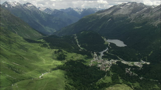 AERIAL Village and hairpins bends in Alpine landscape, Graubunden, Switzerland