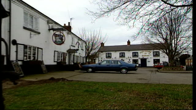 leicestershire queniborough ext general views of village / 'the britannia inn' pub / notice in window of pub about public meeting / village general... - strohdach stock-videos und b-roll-filmmaterial