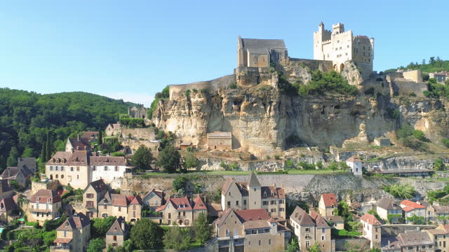 village around chateau de beynac (beynac castle) and dordogne river / france - rock face stock videos & royalty-free footage