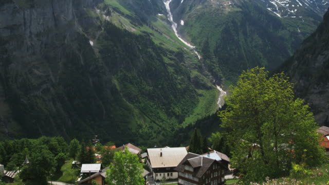 village at the base of a mountain - gimmelwald stock videos & royalty-free footage