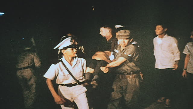 village burning as the wounded are evacuated / vietnam - injured video stock e b–roll