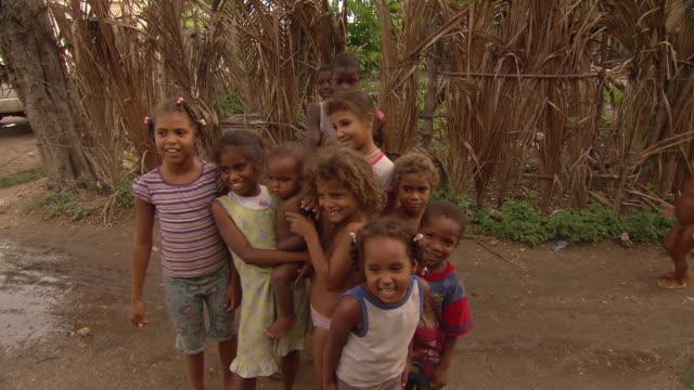 village children pose near a swamp in the dominican republic. - ドミニカ共和国点の映像素材/bロール