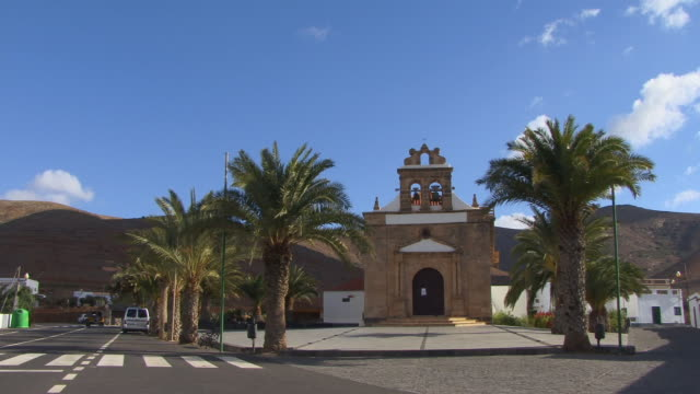ws, pan, village church on street corner / vega de rio palmas, fuerteventura, canary islands, spain - unknown gender stock videos & royalty-free footage