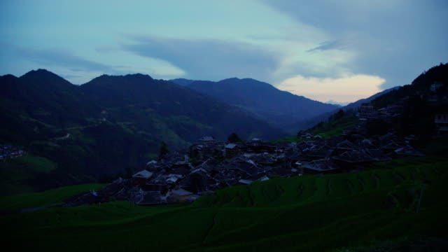 village houses among the rice terraces at sunset,jiabang,guizhou,china. - rustic stock videos & royalty-free footage