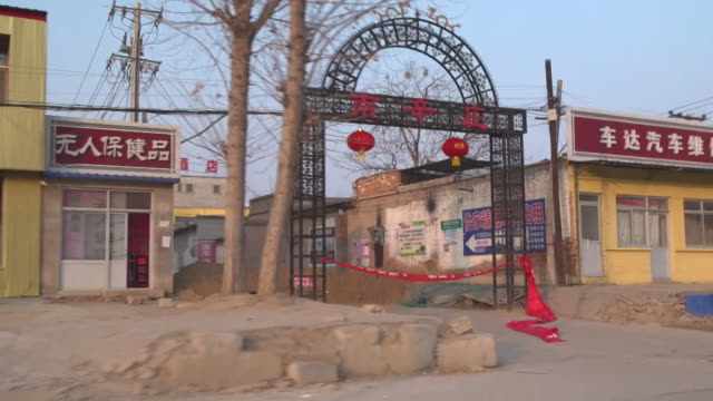 village in china shut down and villagers put up road blocks to prevent the spread of coronavirus - lockdown stock videos & royalty-free footage