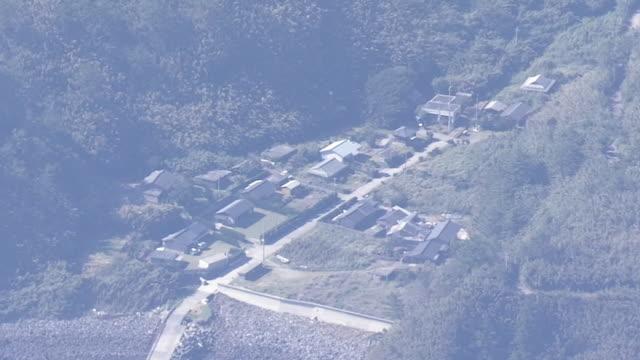 aerial, village in kuchinoerabujima is, kagoshima, japan - philippine sea stock videos & royalty-free footage