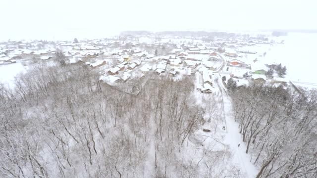 aerial village in the snow - prekmurje stock videos & royalty-free footage