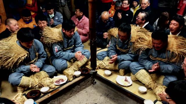 Village men sing and drink sake at the beginning of the Nozawaonsen Dosojin Fire Festival on January 15 2018 in Nozawaonsen Japan The festival is...