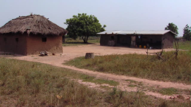 ms village mud hut and shack, tamale, ghana - strohdach stock-videos und b-roll-filmmaterial