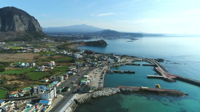 village near sanbangsan mountain, sagyehang port and yongmeori beach / seogwipo-so, jeju-do, south korea - bay of water stock videos & royalty-free footage