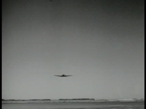 stockvideo's en b-roll-footage met village of huts in desert ws c47 skytrain airplane flying by camels standing on field airplane flying pass bg ms c47 transport airplane driving on... - 1943
