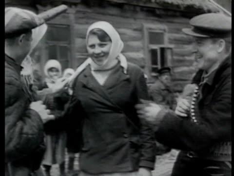 village of orlav. soviet guerillas talking w/ village females. vasily assembling rifle. men placing shield on artillery anti-tank gun. small bridge... - russian ethnicity stock videos & royalty-free footage