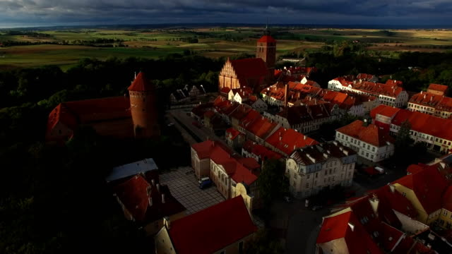 Village of Reszel with its castle/château, church, red roofs houses