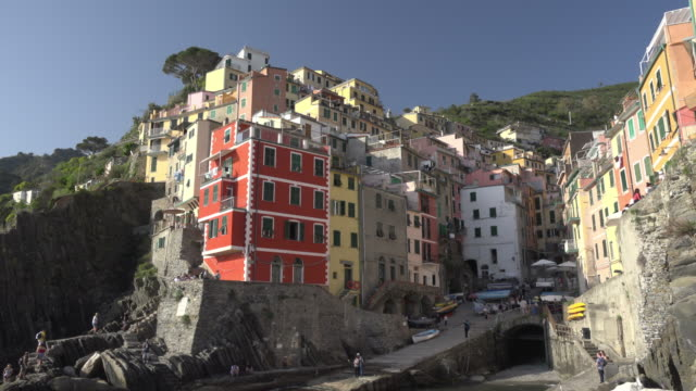 village of riomaggiore over the mediterranean sea - besichtigung stock-videos und b-roll-filmmaterial