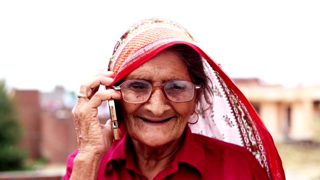 hd: village older women talking on the phone - indian subcontinent ethnicity stock videos & royalty-free footage
