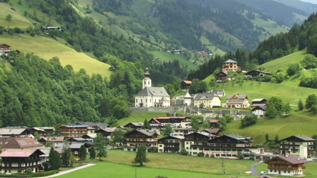 ha, ws, village on green  hillside, grossarltal austria - stationary process plate stock videos & royalty-free footage