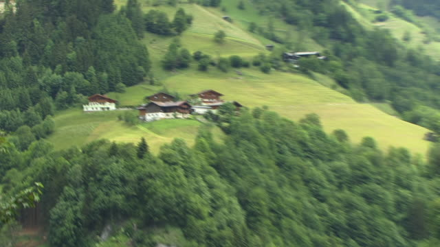 zo, ha, ws, village on green  hillside, grossarltal austria - traditionally austrian stock videos & royalty-free footage
