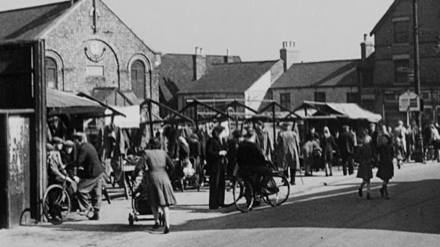 montage village sidewalks, traffic, pedestrians, and kitchens / united kingdom - teekessel stock-videos und b-roll-filmmaterial