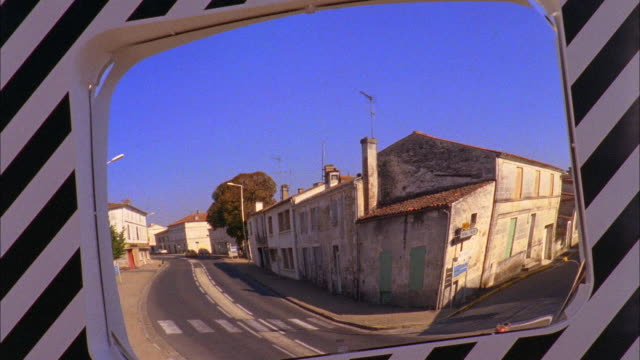 cu village street reflected in road mirror, beurlay, france - ecke eines objekts stock-videos und b-roll-filmmaterial