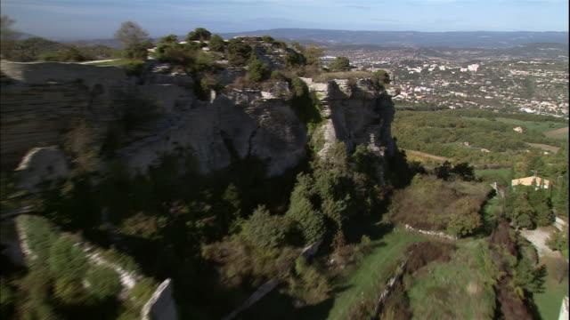 a village stretches across a hilltop in saignon, provence, france. - saignon stock videos & royalty-free footage