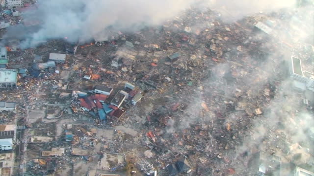 village struck by massive tsunami waves on march 11 in iwate prefecture, japan. this aerial image was shot on yamada,otsuchi and kamaishi.video was... - real time footage stock videos & royalty-free footage