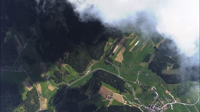 AERIAL Village through clouds / Attersee, Upper Austria, Austria