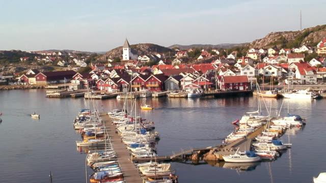 WS HA Village with sailboats moored to marina / Sharhamn, Tjorn Island, Bohuslan, Sweden