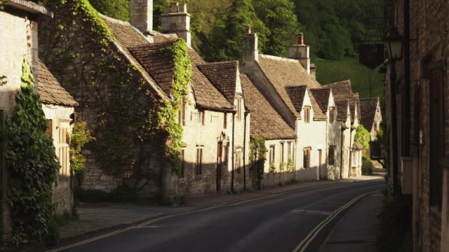 ws village with stone houses / castle combe, cotswolds, wiltshire, uk - cotswolds stock videos & royalty-free footage