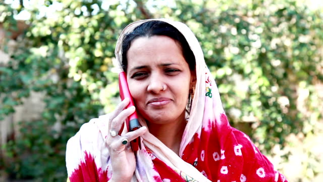 village women talking on mobile phone - south asia stock videos and b-roll footage