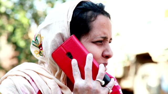 village women talking on mobile phone - handheld stock videos & royalty-free footage