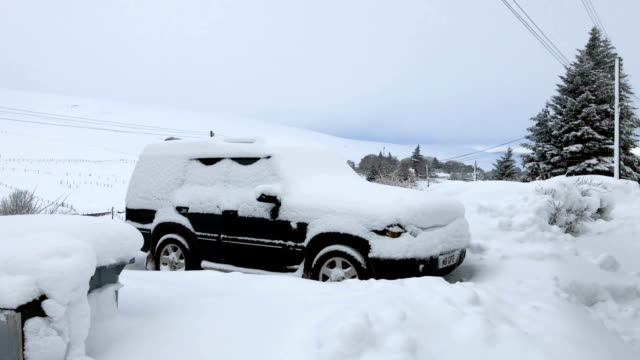 A villager clears the extensive snowfall outside her home which has fallen during the last forty eight hours on January 18 2018 in Leadhills Scotland...