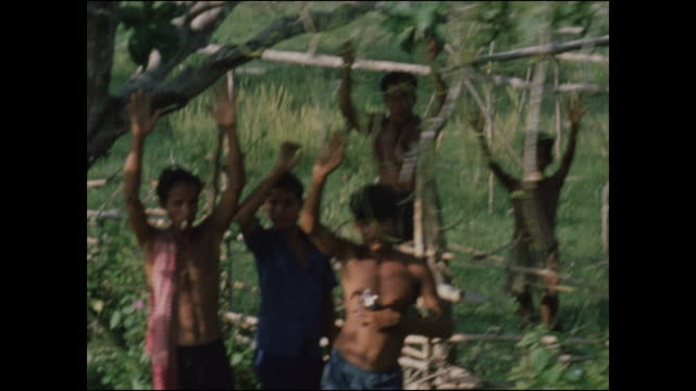 vídeos de stock e filmes b-roll de villagers alongside road wave and cheer as soldiers on an armored personnel carrier look down. 2 /47th mechanized infantry of the ninth infantry... - camboja