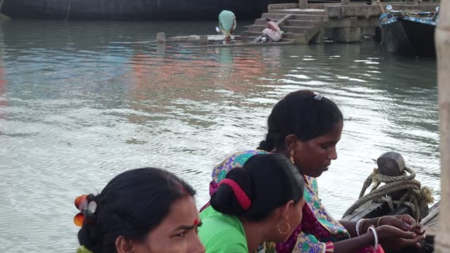 villagers are crossing river chenai by boat at sunderbans delta. the river is a tributary of river hooghly. sunderbans, south 24 pargana, west... - hooghly river stock videos & royalty-free footage