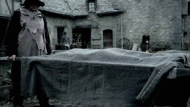 villagers cart away corpses during the black plague. - historical reenactment stock videos & royalty-free footage
