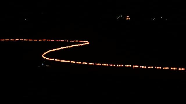 fuzhou, china - february 3, 2017: villagers celebrate chinese new year with the long bridge dragon lantern at night. - lantern stock videos & royalty-free footage