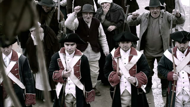 villagers chant as french soldiers stand guard. - french revolution stock videos & royalty-free footage