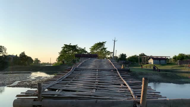 villagers crossing a bamboo-made bridge over water body in a village in barpeta, india on 09 november 2020. without any financial support from the... - lagoon stock videos & royalty-free footage