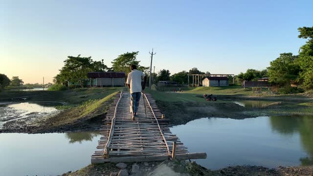 villagers crossing a bamboo-made bridge over water body in a village in barpeta, india on 09 november 2020. without any financial support from the... - bamboo plant stock videos & royalty-free footage