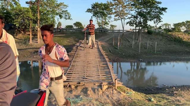 villagers crossing a bamboo-made bridge over water body in a village in barpeta, india on 09 november 2020. without any financial support from the... - backgrounds stock videos & royalty-free footage