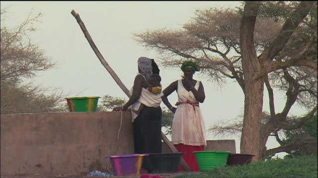 WS Villagers drawing water from the well to take home / Africa