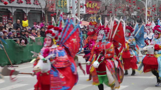 ms villagers dressed as ancient figures attend parade during shehuo celebrations, shehuo is traditional festive folk celebration during chinese spring festival  audio  / xi'an, shaanxi, china - chinese new year stock videos & royalty-free footage