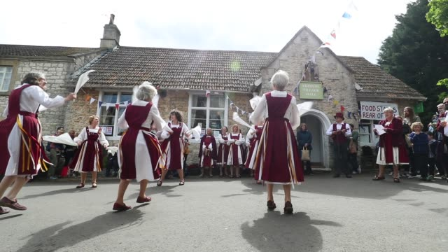 villagers enjoy the traditional may day bank holiday festivities - traditional ceremony stock videos & royalty-free footage