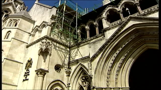 Villagers in Derbyshire fail to stop private American company running their GP service London High Court Low angle shot of sign 'Royal Courts of...