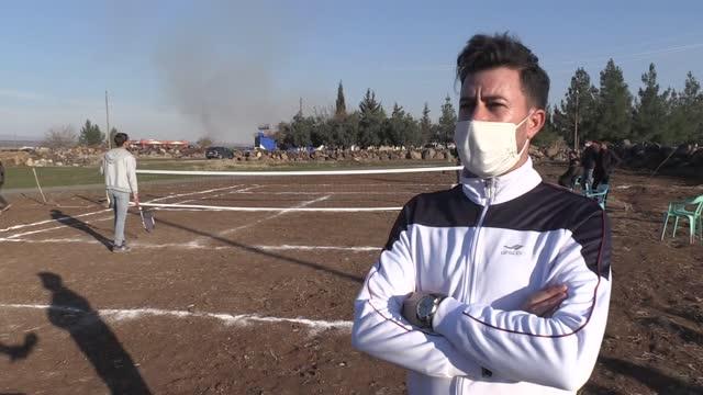 villagers met tennis thanks to the village's physical education teacher turkey's southeastern province of sanliurfa play tennis in their local... - tennis racket stock videos & royalty-free footage