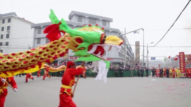 ms ts villagers performing dragon dance in traditional festive folk celebration or carnival during chinese spring festival audio / xi'an, shaanxi, china - dragon stock videos & royalty-free footage