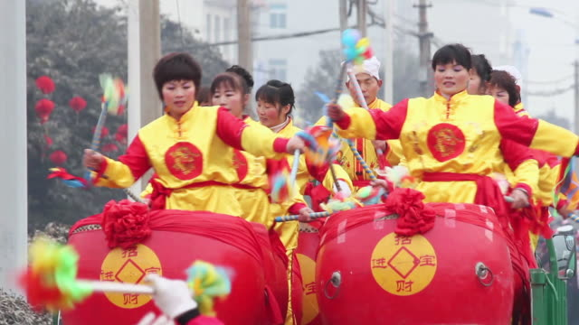 MS Villagers performing gongs and drums in traditional festive folk celebration or carnival during chinese spring festival  AUDIO  / xi'an, shaanxi, china