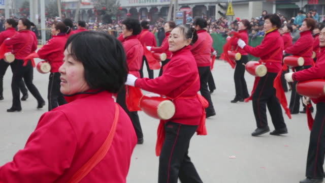 MS PAN Villagers performing with gong and drum in traditional festive folk celebration or carnival during chinese spring festival  AUDIO  / xi'an, shaanxi, china