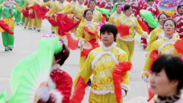 ms villagers performing yangko dance in traditional festive folk celebration or carnival during chinese spring festival  audio  / xi'an, shaanxi, china - hand fan stock videos and b-roll footage